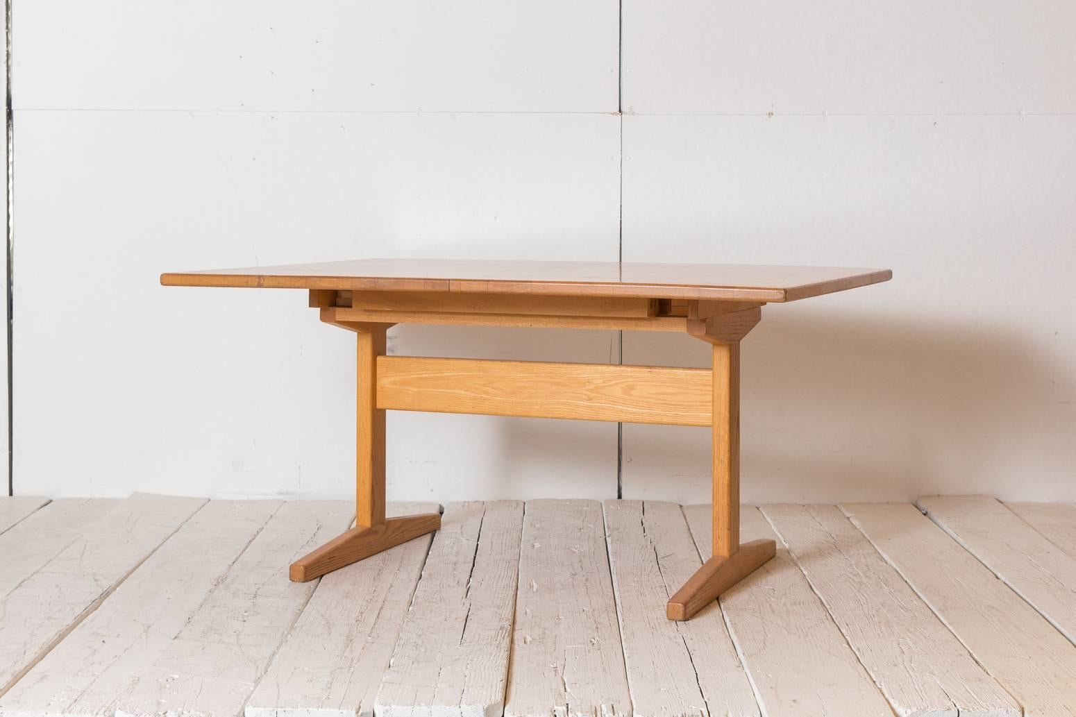 Extendible Shaker Style Oak Rectangular Dining Table With Trestle Base.  Table Measures 109