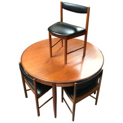 Extending Midcentury G Plan Teak Dining Table with 4 Chairs in Black Vinyl