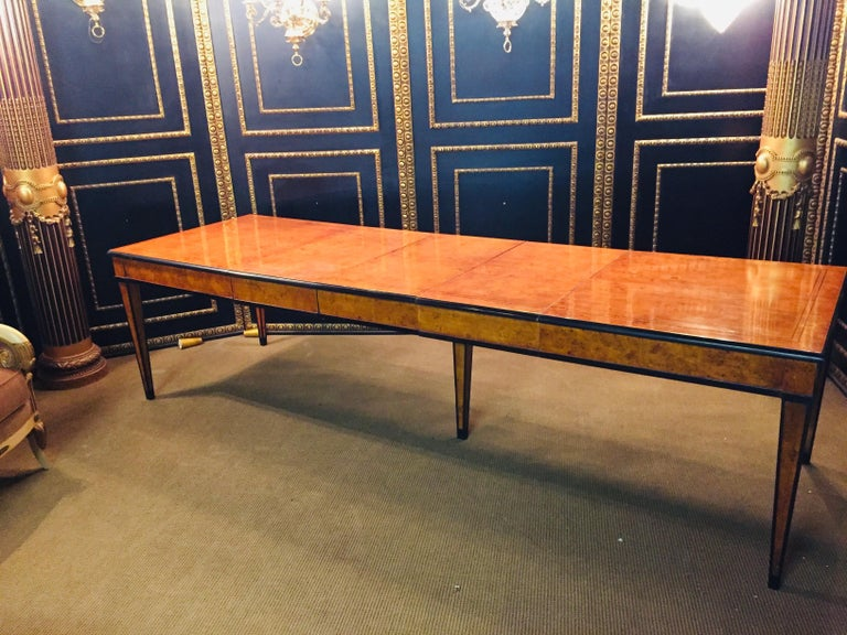 Bird's-eye maple on solid wood. Straight frame base on five high conical square legs, partially ebonized. Low protruding, profiled tabletop also ebonized and double thread inlaid blackened wood. A wonderful maple, veneered. Beautiful patina, with