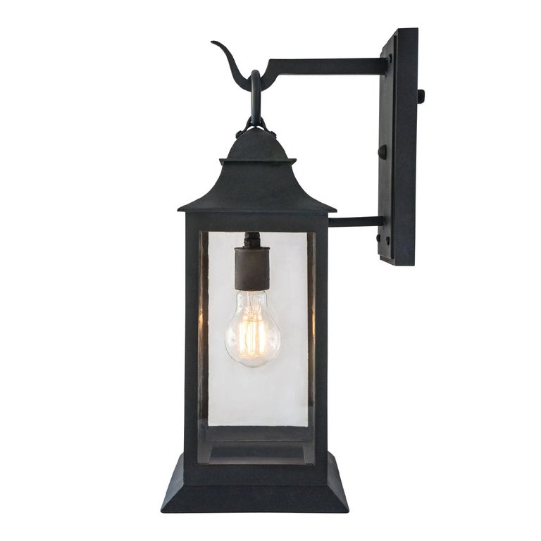 A classic form, with riveted, caged frame, graceful sloped hood, and footed base. At home in an array of settings, from beach house to mountain chalet.