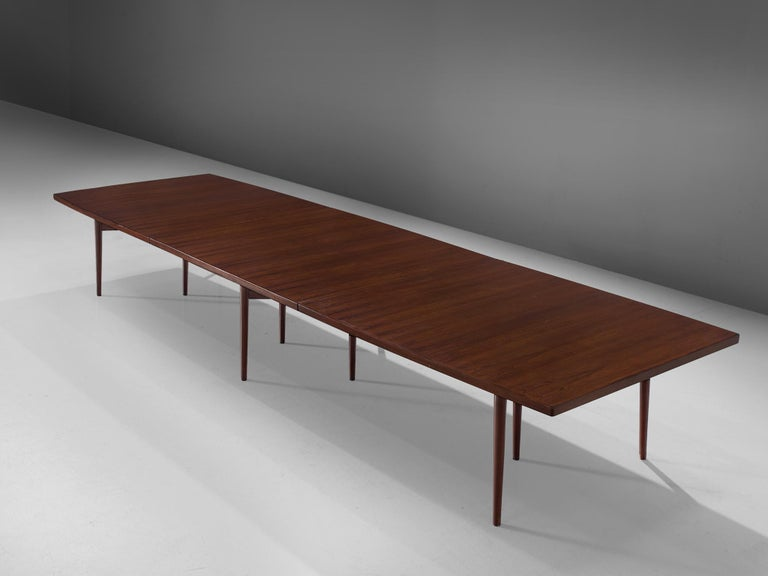 Arne Vodder for Sibast Furniture, rosewood, dining table, Denmark, 1960s.  This dining table or conference table is executed with rosewood veneer. The straight top that is made out of three pieces is supported with a sculptural frame that has