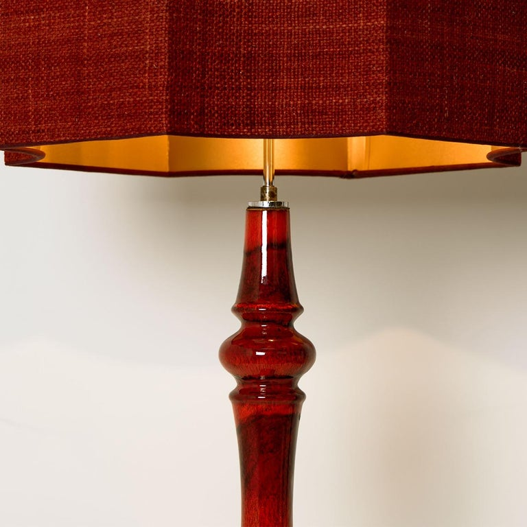 Exceptional large ceramic bubble floor lamp, Germany, 1960s. A sculptural high-end piece made of handmade ceramic in rich glazed dark red tones. With a new custom made blue silk lamp shade by René Houben. With fringes from Houles Paris and a warm