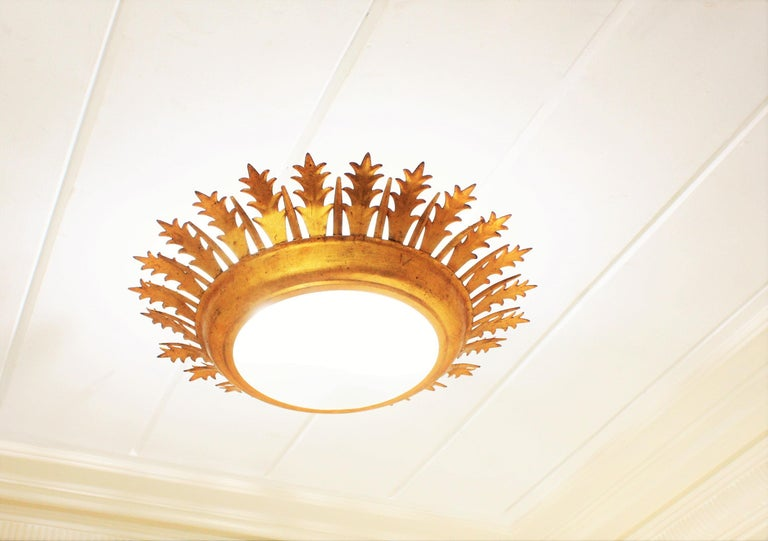 Spanish Extra Large Gilt Iron Crown Sunburst Ceiling Light Fixture with Frosted Glass For Sale