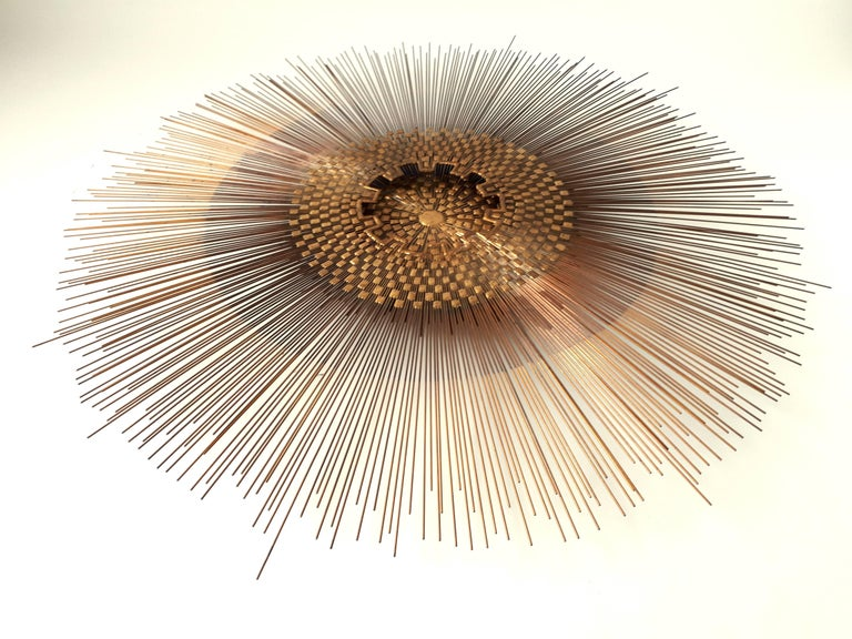 Well made 2 tier densely assembled steel rods with brass welding and accent.   Measure 48 inches wide.  Ready to hang .