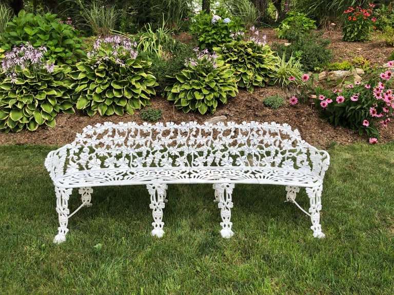 Extra large neoclassical floral garden bench. Perfect for a garden or patio. Extra long for plenty of seating. Ornate scroll work with flowers. Lightweight for easy moving. This bench has an elaborate grapevine design with large grape leaves and