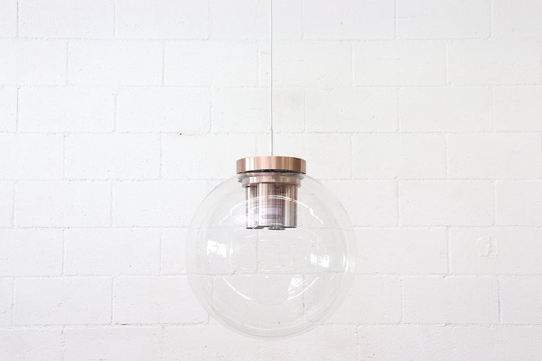 Extra large RAAK blown glass ceiling lamp with copper toned hardware. Four udder-like cylinder sockets encased in a huge blown glass globe. 2 of the tops have a hole drilled in the cover, may. Have been for a cable support. Does not detract from the