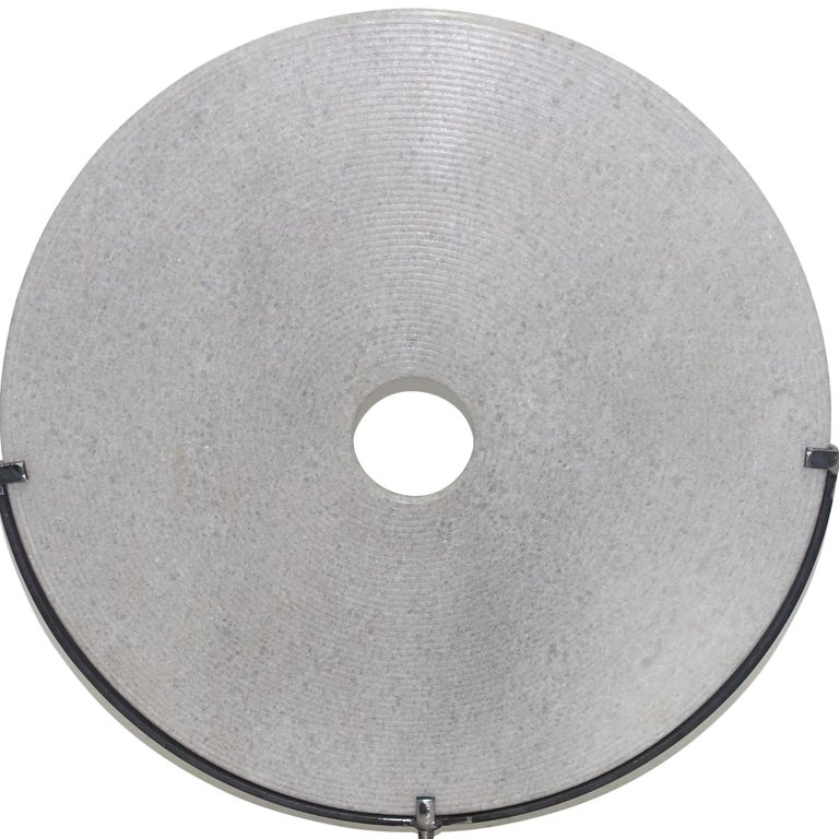 Contemporary Chinese extra large ribbed white stone disc on steel stand. Also available in black stone (S5104) Stand measures 12