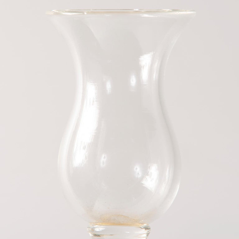Very tall Seguso clear and gold Murano glass candlestick, circa 1960s.