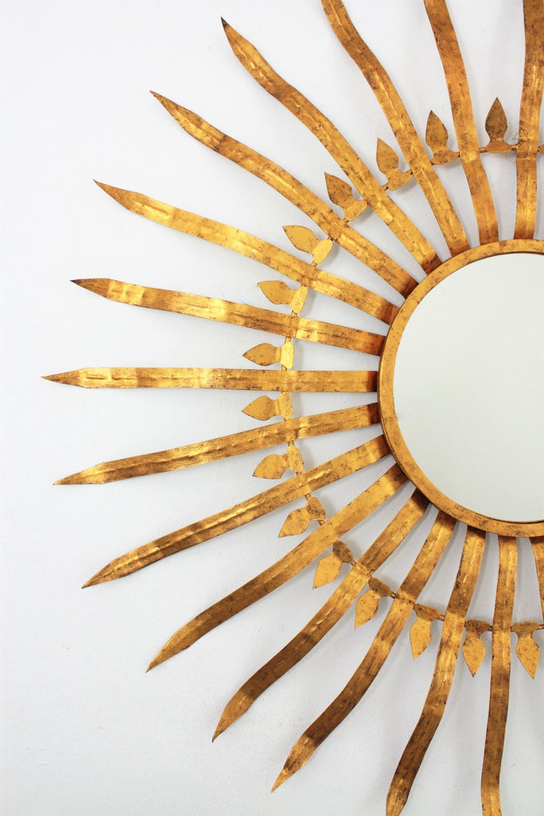 Mid-20th Century Extra Large Spanish 1950s Hollywood Regency Gilt Iron Convex Sunburst Mirror For Sale