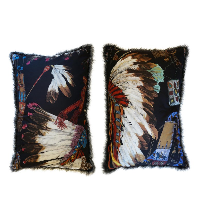 """This large dream pillow design is made with Pierre Frey's Grand Canyon fabric featuring a hand drawn design with """"a veritable tribute to the opulent and majestic headdresses of Native American tribal chiefs. Each feather or jewellery ornament has a"""