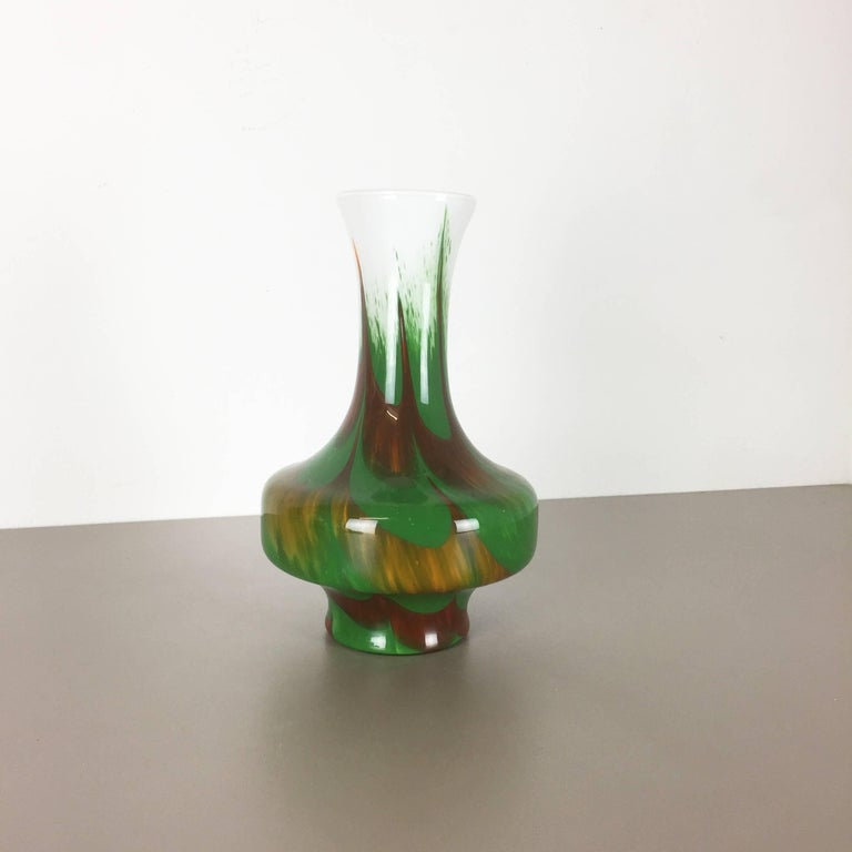 Article:  Pop art vase   Producer:  Opaline Florence   Design:  Carlo Moretti    DECADE:  1970s   Description:  Original vintage 1970s pop art handblown vase made in Italy by Opaline Florence. This vase was designed by Carlo