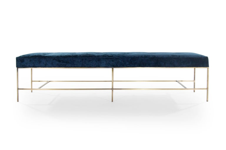 The Architectural Bench is light and angular with impeccable lines. The extra-long cushion upholstered in blue chenille is uplifted with an antiqued brass frame. Paul McCobb's design influence shines through with masterful minimalism. Slender legs