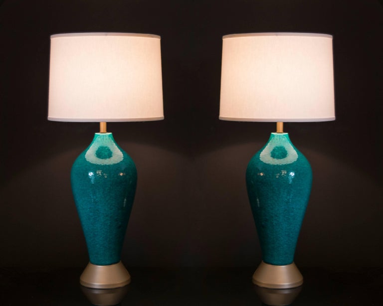This pair of lamps has the most beautiful color of turquoise with a mottled glaze finish. The lamps are in excellent condition with the exception at the top of the lamps there are some glazing drips. These are not noticeable nor do they detract from