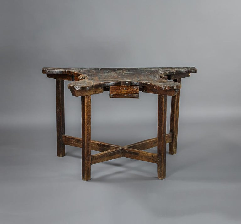 Early 19th century jewelers table, workstation for three craftsmen, each with a small drawer to catch any falling precious metals. Wonderful patina to the fruitwood surface. Makes an unusual home office workstation.