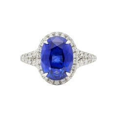 Extraordinary 5.08 Carat Unheated Sapphire in Custom Platinum and Diamond Ring