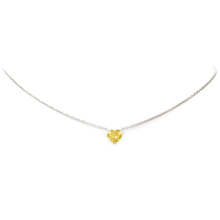 This is an extraordinary expression of love!  Boasting a Natural Fancy Intense Yellow Heart shaped Gia  Certified diamond, this necklace pops with vibrant color.  Attached stationary to the center of this 15.5 inch cable chain.  Heart Diamond