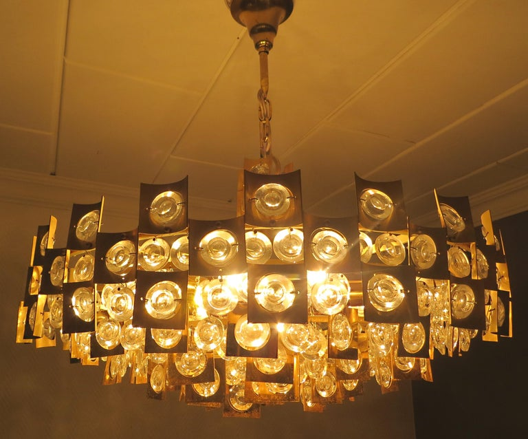 A very representative, luxury, modern and unique midcentury vintage chandelier with a oversize diameter of 23 inches,
