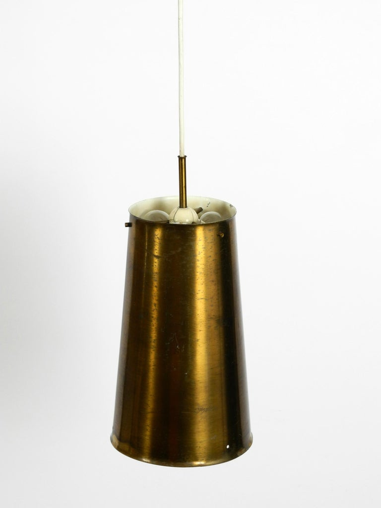 Very rare large Mid-Century Modern pendant lamp, shade is made of copper. Manufactured By Bochumer Lampenfabrik 1950. Made in Germany. It has one E27 socket inside the lampshade and three E14 sockets above. Exceptional design in original