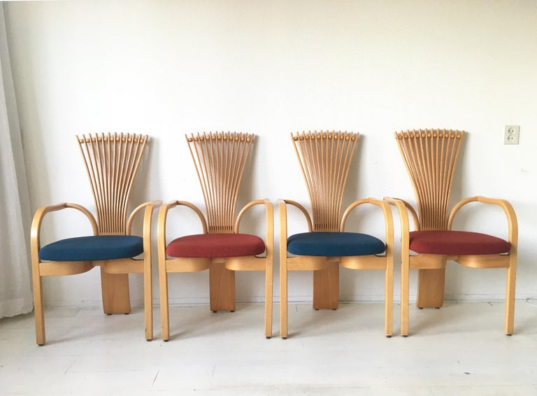 These sculptural Norwegian high back dining chairs were designed by Torstein Niksen for Westnofa. This Fan, or Totem chairs feature a massive Oak base with Blue and Red wool upholstery. If desired, they can easily be reupholstered with another