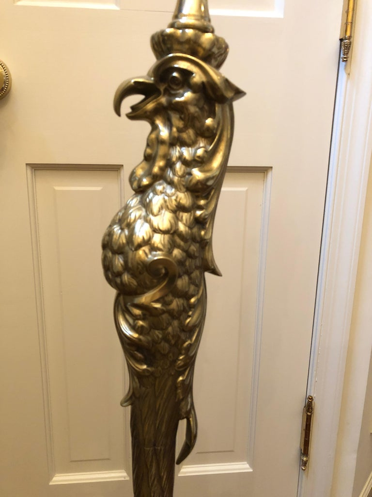 An incredible antique cast brass floor lamp by P. E. Guerin in the form of a stylized bird of prey having single elongated scaly leg and dramatic oversized claw foot with talons that form the base. Impressed on the upper rear talon is Patented April