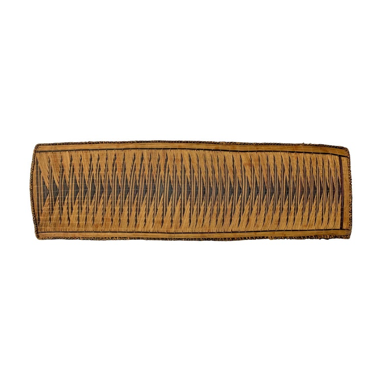 An extraordinary 20th century Tutsi handwoven reed and grass screen with a fantastic geometric pattern woven in dark violet grasses, used to protect milk pots, on custom wall mount that can be hung vertically or horizontally.  Ex. Rutton-Hourde,
