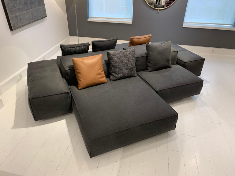 Extrasoft 8-piece modular sofa in gray fabric. Spacious and comfortable, the Extrasoft sofa is perfect for any living room. Designed by Piero Lisoni. 