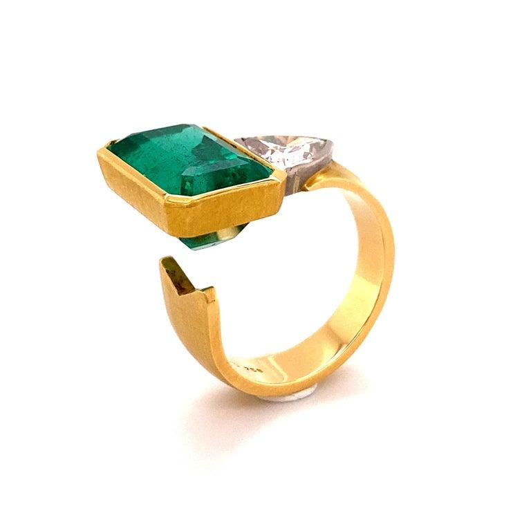 Emerald Cut Extravagant Emerald and Diamond Ring 18 Karat Gold For Sale