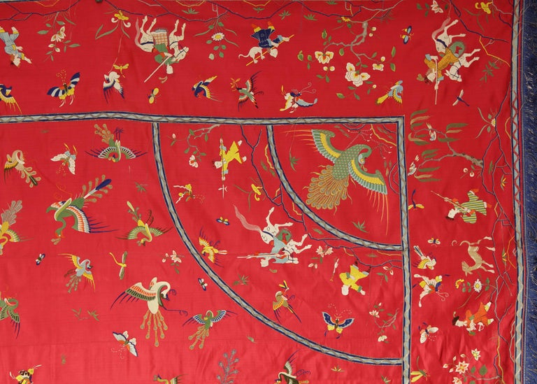 A Chinese red silk, embroidered bed cover  Guangdong or Macao, mid-18th century  The red silk cover, one one side elaborately embroided in coloured silk and gilt-paper-wrapped thread, with a central medaillion with Phoenix, surrounded by various