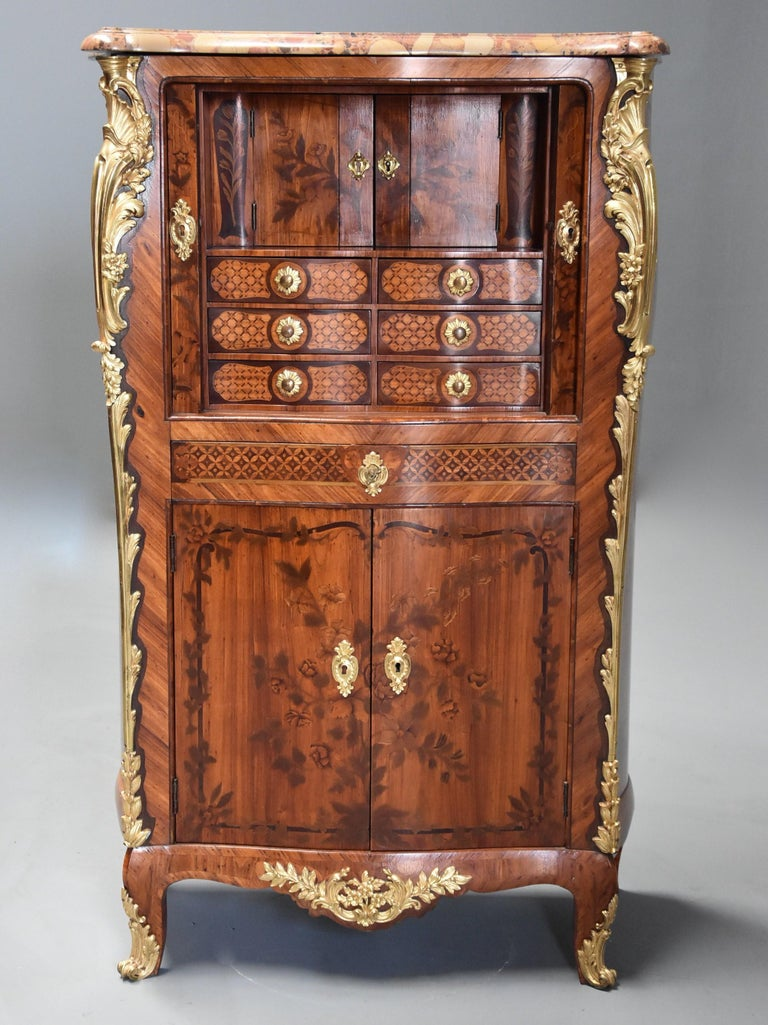 Extremely rare French fine quality mid-18th century (circa 1760) Louis XV tulipwood, amaranth, stained sycamore and fruitwood floral marquetry and parquetry secretaire cabinet with tambour front, attributed to Roger Vandercruse, also known as