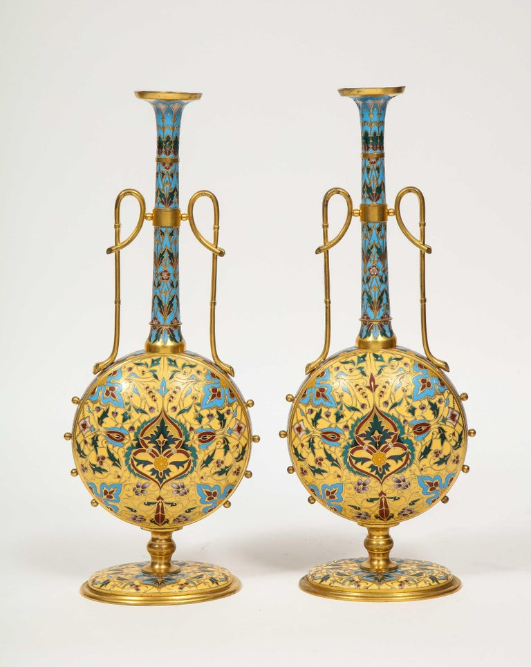 An extremely rare, museum quality pair of Ferdinand Barbedienne ormolu and champlevé enamel vases, circa 1870, certainly designed by Louis Constant Sevin.  Very unusual form and shape. Enameled with vibrant colors, in the Persian taste.  An