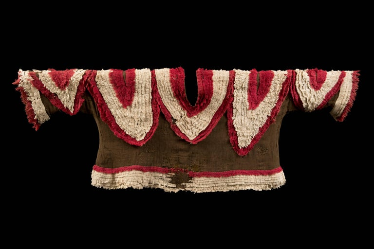 Chimu brown gauze shirt with multiple red and white fringe lines forming V designs like the one around the neck, with very rarely seen sleeves and border fringe in the same material.
