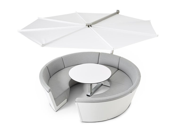 Kosmos is a combination of lounging function as a sofa and a daybed. The table-seat combination makes efficient use from the space available by combining different functions, such as a sofa, a dining table, light, a parasol, and a daybed (the