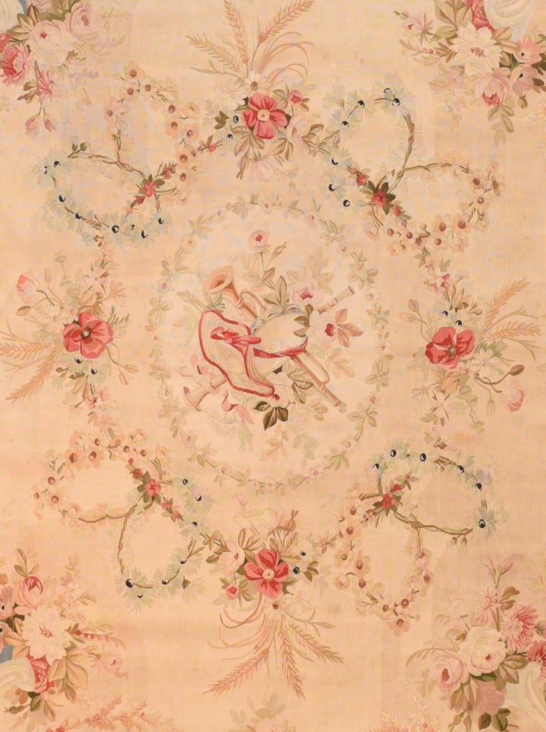 Extremly fine antique Aubusson-Beauvais French tapestry, hand knotted, circa 19th century  Design: Flower Instrument  The Aubusson tapestry manufacture of the 17th and 18th centuries managed to compete with the royal manufacture of Gobelins