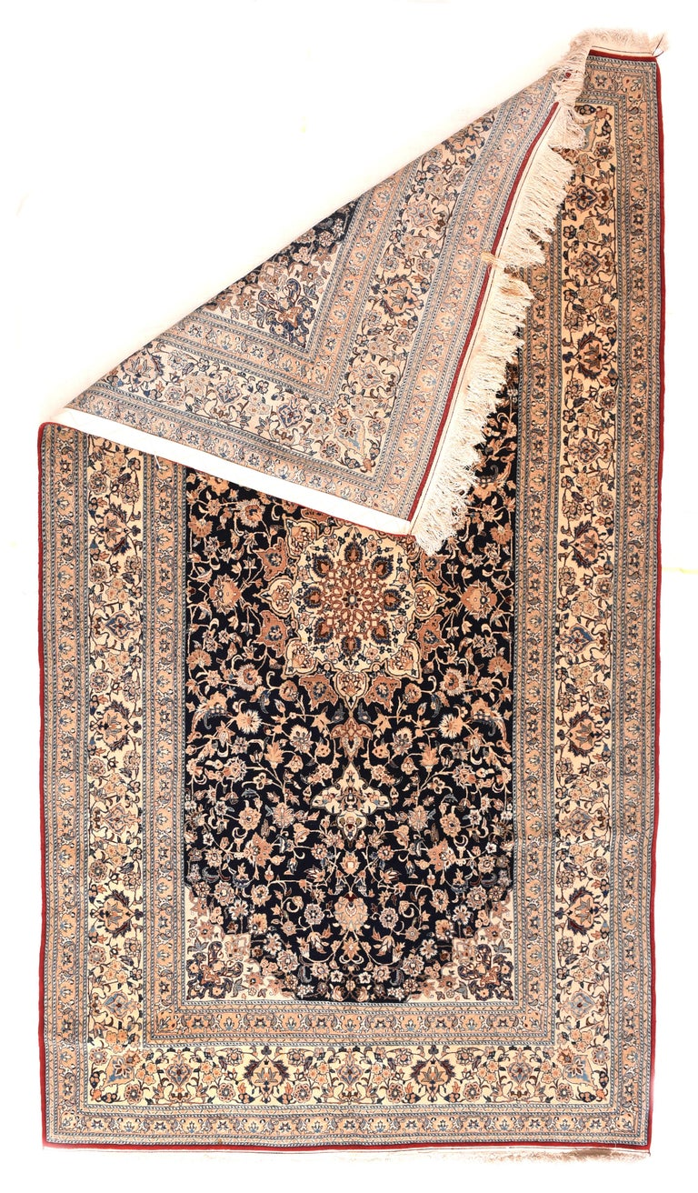 Nain rugs are constructed using the Persian knot and typically have between 300 and 700 knots per square inch. The pile is usually very high quality wool, clipped short, and silk is often used as highlighting for detail in the design.  Close to the