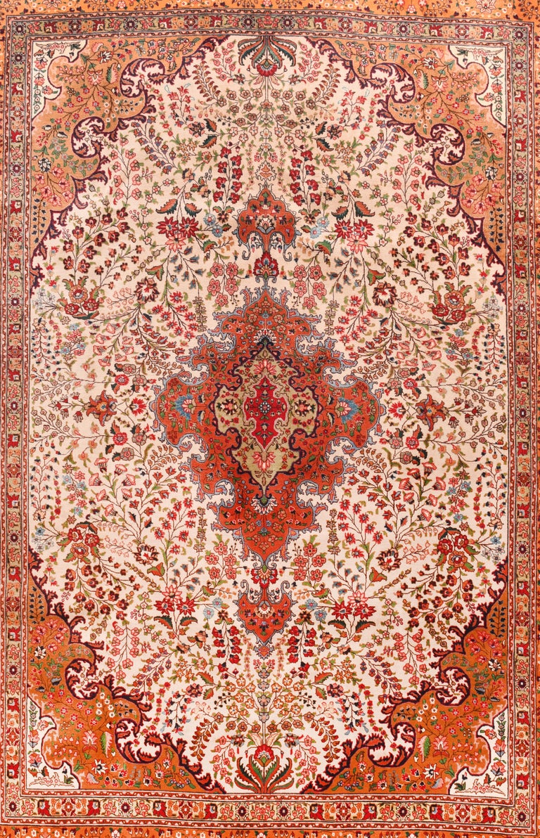 Extremely fine vintage Persian Tabriz rug, hand knotted, circa 1970s  Design: Center Medalion  A Tabriz rug/carpet is a type in the general category of Persian carpets. from the city of Tabriz, the capital city of East Azarbaijan Province in