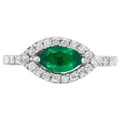 Eye Style Emerald with Diamonds Ring