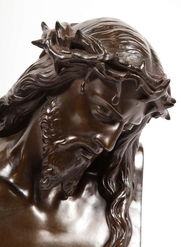 An exceptional French patinated realistic bronze bust of Jesus Christ, circa 1858    Signed: J CLESINGER. & F. BARBEDIENNE FONDEUR, with the Reduction Mecanique seal.    Measures: 12.5