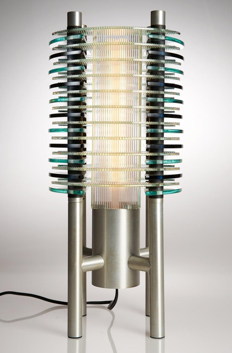 Create a bold statement with this table lamp designed and created by Sidney Hutter Glass & Light. Originally designed in 1988, this work of art stands the test of time making a bold statement in today's contemporary setting. The lamp has been