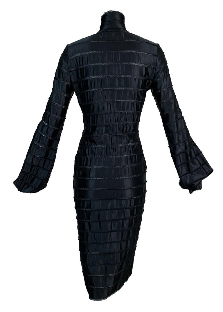 DESIGNER: F/W 2002 Yves Saint Laurent by Tom Ford  Please contact for more information and/or photos.  CONDITION: Good- no flaws  FABRIC: Unknown- bottom layer is a mesh with what feels like silk ribbons layered on top.   COUNTRY MADE: France  SIZE: