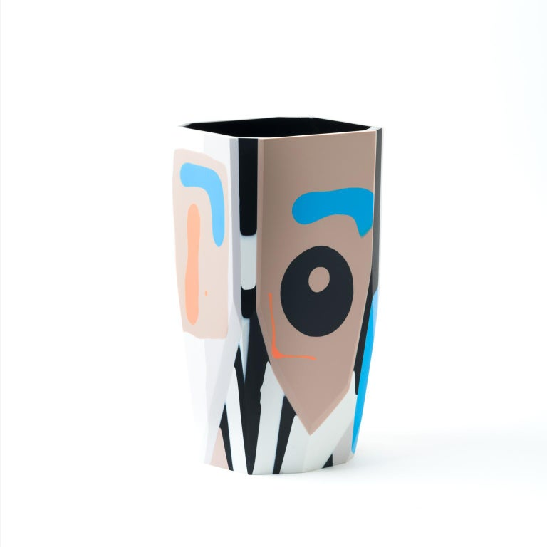 The graphic and bold Kalahari vase is a new addition to our Black Magic collection of resin vessels, inspired by the concept of revealing that which has been hidden from sight, but remains ever-present.  Gazing toward the past, to cultures and
