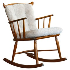 Faarstrup 1950 Low Spindle Back Rocking Chair with Shearling Cushions