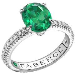 Fabergé 18 Karat White Gold Oval Emerald Ring with Diamond Set Shoulders