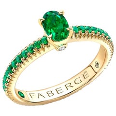 18k Yellow Gold Oval Emerald Fluted Ring with Tsavorite Shoulders