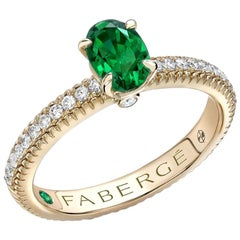 Fabergé 18 Karat Yellow Gold Oval Emerald Ring with Diamond Set Shoulders