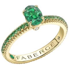 Fabergé 18 Karat Yellow Gold Oval Emerald Ring with Tsavorite Set Shoulder