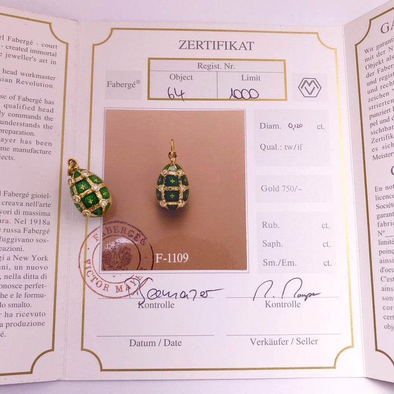 This 18 karat yellow gold and green enamel egg was crated by Victor Mayer. Crafted in the tradition of the original Imperial eggs, this pendant egg features Faberges iconic Guilloché  enameling in green which is detailed with 6 mini gold motifs. The