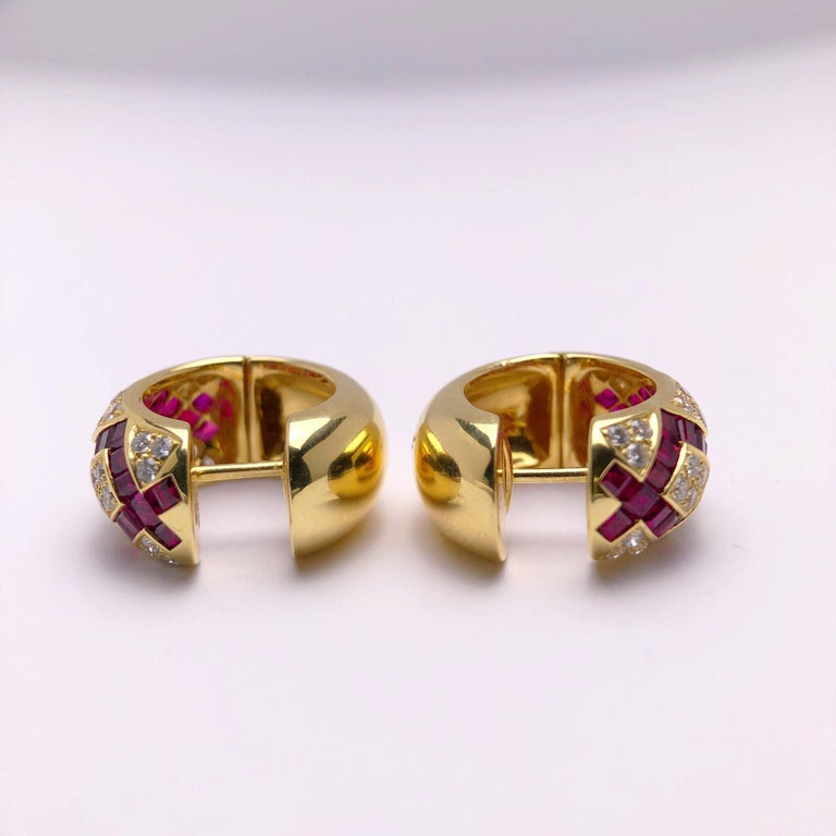 These stunning Modern 18 karat yellow gold, diamond and ruby earrings were created by Victor Mayer for Faberge. Crafted in the tradition of the original House of Faberge, with meticulous attention to detail, these earrings are classic and