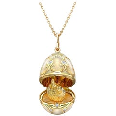Palais Tsarskoye Selo Yellow Gold Locket with White Enamel and Hen Surprise