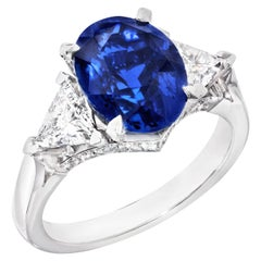 Platinum Oval 5.12ct Royal Blue Sapphire Ring Set With White Diamonds