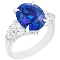 Platinum Oval Blue Sapphire Ring Set With Pear Shaped & Round White Diamonds